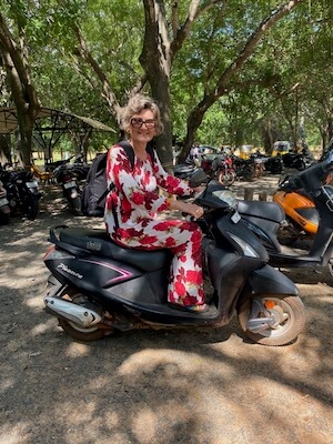 Claudia on a motorbike in Auroville